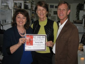CHMC VP Patty Howell presents Karen and Tim Jobe with $1,100 prize